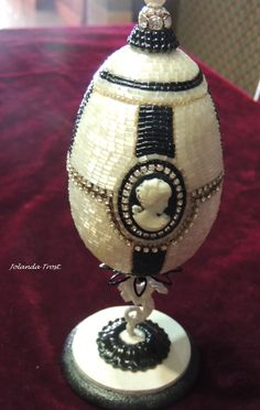 Goose Egg, trinket box.  Bugle beads, rhinestone chain and cameo