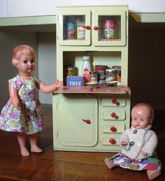 1950s toys.....i played all day with my dolls. Cute doll kitchen too.