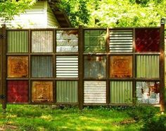 creative fences  love it love it love it !!! Great for a backyard focal piece!!