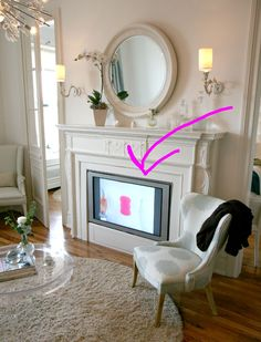 Before there was just a flat wall, but Kelly found an old fireplace mantel that could also serve as a flat screen's housing.