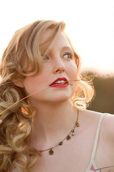 Sideswept curls and a bright berry lipcolor...easy and yet stunning beauty look to try.