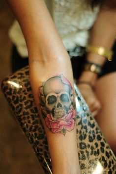 Semi-realistic skull like this one I love. This tattoo is great.