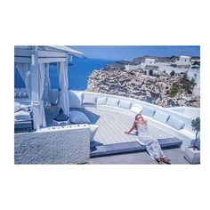 """""""Relaxing and falling in love with Santorini… at Volcano View Hotel"""" After an exhilarating massage atop the sea, happy guest christianathe worships the Greek sun…How about joining us, too for some well deserved pampering? Fira Santorini, Santorini Hotels, 5 Star Hotels, Volcano, Marina Bay Sands, Worship, Massage, To Go, Greek"""
