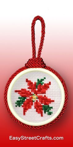 Simple Little Poinsettia Cross-Stitch framed in a double-sided ornament frame fr. - Simple Little Poinsettia Cross-Stitch framed in a double-sided ornament frame from EasyStreetCrafts - Cat Cross Stitches, Counted Cross Stitch Patterns, Cross Stitch Designs, Cross Stitching, Cross Stitch Embroidery, Embroidery Patterns, Hand Embroidery, Cross Stitch Christmas Cards, Xmas Cross Stitch