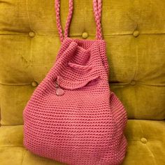 Liz Claiborne Knitted Drawstring Bag I'm dreaming of festival season! But really this has been my favorite festival bag, pink knitted with spacious cream interior and one deep pocket on the front on the bag. Bottom has a few dirt spots but she's been to some great shows. Braided draw strings, bag sits lower on your back. No marks other wise on this fun flirty pack. Liz Claiborne Bags Backpacks
