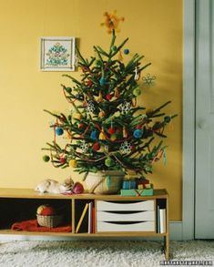 Albero di Natale con lana e pon pon