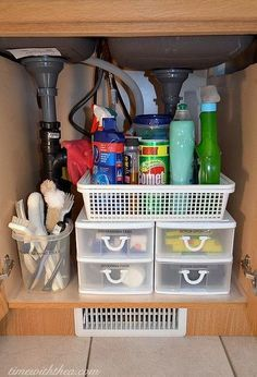 inexpensive storage ideas to make the most of a kitchen sink cabinet #organizing #organization #kitchencabinets