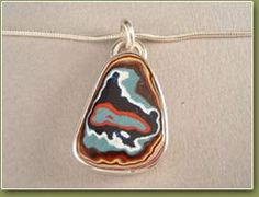 This one looks like a topo map - more Fordite.