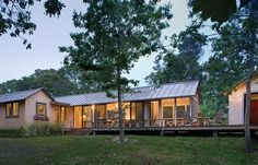 The 1,344-square-foot house is topped with a standing seam metal roof and clad in simple, white cedar shingles.