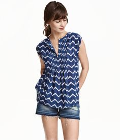 Wide V-neck blouse in an airy, patterned cotton weave with pin-tucks at the neck and front and short cap sleeves.
