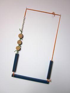 Karen Vanmol  Necklace: Under construction 2010  Wood, silver, cotton, paint  20 cm x 38 cm x 1 cm