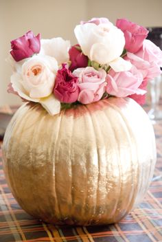 Metallic gold pumpkin rose centerpiece