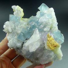 Blue Fluorite with rare purple Calcite on a Quartz...