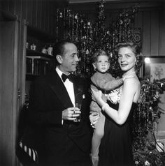 American actor Humphrey Bogart (1899 - 1957) with his wife Lauren Bacall and their son Stephen at their home in Beverly Hills in California on Christmas Eve.