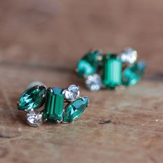 Vintage emerald green glass and crystal rhinestone earrings set in gold