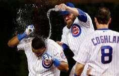 Forecast: Showers -        Jason Motte of the Chicago Cubs dumps water on Starlin Castro after he hit a walkoff RBI single against the Cincinnati Reds June 13 in Chicago. The Cubs won 4-3.      -    © Jon Durr/Getty Images