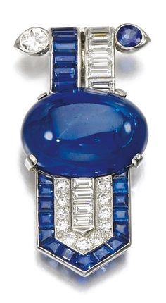 An Art Deco sapphire and diamond clip, circa 1930. Claw-set with a cabochon…