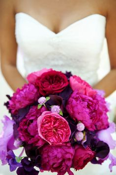 elegant malibu wedding with bold wedding flowers pink purple bridal bouquet