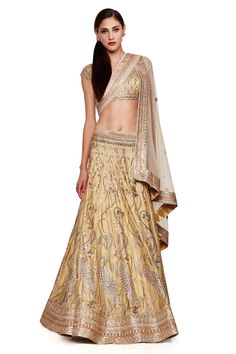 Presenting a beautiful flamingo embroidered lehenga with a sensuous gold gota patti choli and a matching gold dupatta. Flaunt the royal aura of this trousseau by pairing it with a stunning neckpiece and earrings.$385,000.00
