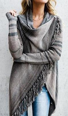 We love the coveted ombre Tassel Asymmetrical Hem Shawl Cardigan! A spinoff from our classic Shawl Fringe cardigan, this piece is adorable in multi hued fade of grey and taupe! Don't forget about the fringe on the hem! This piece is perfect to layer up for fall! The one sided fringe and button closures are perfect for wrapping up on chilly nights.