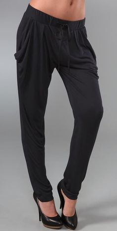 Horrible, unflattering baggy pants (these were terrible in the 90s with boots, even worse with heels)...oh my...these are $242...lol!!! STOP PINNING THESE....THIS STYLE MUST DIE!! LOL