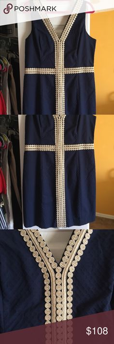 Lilly Pulitzer upshift dress. Navy blue w gold pattern design . Fits beautifully. NWT. In in invisible zip. Great for any occasion . Bought at full retail . Comes from smoke free home . Gorgeous !!! Hard size to find . Dresses Midi