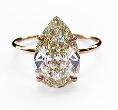 2.50ct Pear shape diamond set in a very simple gold wire band setting. DREAM RING