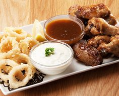 Buffalo Wings & Calamari: A delicious combination of your favourites - served with either our tangy tartare, Durky or sweet chilli sauces. https://www.spur.co.za/menu/starters/