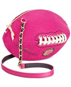 """Fashion's Mvp! Up your glam game instantly with Betsey Johnson's football bag featuring lace-up and chain-link details.   Faux leather   Imported   11""""W x 5""""H x 5""""D   22""""L crossbody strap   Zip closur"""