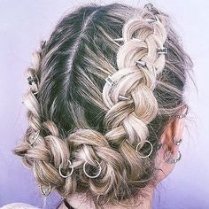 Hair piercings are popping up ALL over Instagram right now, with the hair trend enjoying a 2016 revival thanks to our new love of fancy plaited 'dos.  For the unitiated, hair piercings are a bit like hair gems, except that instead of being stuck on top of the hair, they're fastened through it – meaning a plaited style is best for keeping them in place.