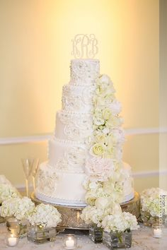 This stunning cake has roses piped all over it and a cascade of fresh flowers! How To Pipe Roses, Fondant Wedding Cakes, Victoria Wedding, Fondant Rose, Happily Ever After, Fresh Flowers, Monogram, Photoshoot, Wedding Ideas