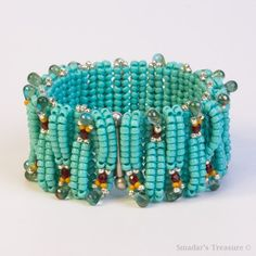 Turquoise Beaded Bracelet with Touches of Ruby Silver and