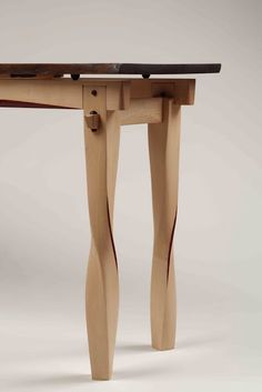 """Chen Yu-Chein 陳幼健 """"For me, carpentry is work of the heart,"""" he says. """"My designs may not always be practical, but they're reflections of my feelings and memories."""" Chen's designs are complex but the twist on these legs are beautiful."""