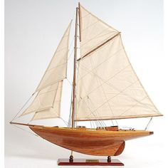 Ahoy! Add a nautical theme to your decor with this beautiful wooden model ship, which boasts many ornate details, including stitched sails and rigging to the ship's tiny cabin. This stunning model is the perfect piece for your favorite sailor.