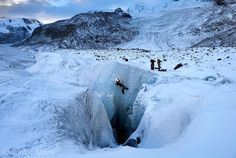 """""""Photo by @shonephoto (Robbie Shone) - Explorers install a rope on the head wall of a large moulin on the surface of the Gorner glacier in Switzerland.…"""""""