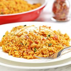 Tomato Rice - easy summer side dish with Mediterranean flavors: olive oil, garlic, tomatoes and oregano.