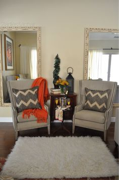 Let's talk symmetry and design. These two chairs from HomeGoods are perfect in this symmetrical setting. The two mirrors contribute to this theme. The HomeGoods faux fur rug is small yet big enough to anchor the space. When seen all together your eyes naturally relax. This creates a cozy scene.  It's an inviting space to start the day or a place to relax when the day is done. Sponsored by HomeGoods