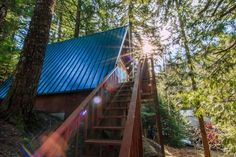 This is a 580 sq. Off-Grid A-Frame cabin for sale in Skykomish, WA and you're invited to come on in to take the full tour and learn more inside! A Frame House Plans, A Frame Cabin, Roof Styles, House Styles, Cabins For Sale, Barn Parties, Lakefront Property, Rustic Chandelier, Country Style Homes