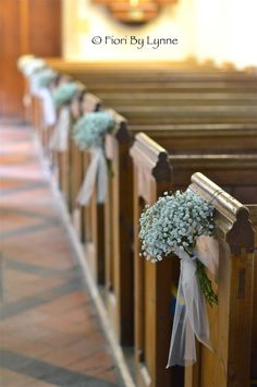 Pew bows Gypsophila pew end with tulle bow and trails. These tied designs are gorgeous for a church wedding.