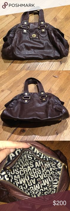 """Authentic Marc by Marc Jacobs Brown Leather Bag Brown supple soft leather. Gold hardware. Marc Jacobs signature interior lining. There is a small stain inside on the bottom of the bag as seen in picture #3. Otherwise decent pre-owned condition. Bag size is 16"""" x 9.5"""" x 7"""" with a 7"""" strap drop. Marc by Marc Jacobs Bags Shoulder Bags"""