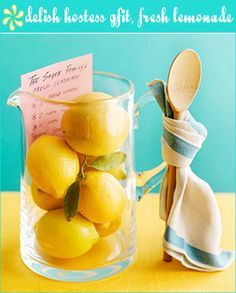 How sweet is this lemonade gift set?  It's great for any summer get-together.  So simple, yet thoughtful.  Include lemons, a recipe for lemonade, a wooden spoon, dishtowel, and pitcher for this hostess gift set...