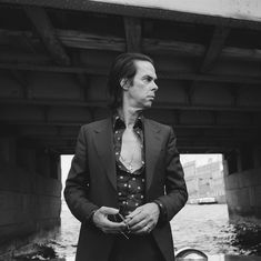 """Nick Cave has urged people to separate Morrissey's """"regressive"""" and """"dangerous"""" beliefs from his music, saying it's important to let Morrissey express his views, and challenge them when necessary. Cave's statement…View Post Midnight's Children, Joel Edgerton, Salman Rushdie, Nick Cave, Susie Cave, Feminist Icons, Reading Music, The Bad Seed, Margaret Atwood"""
