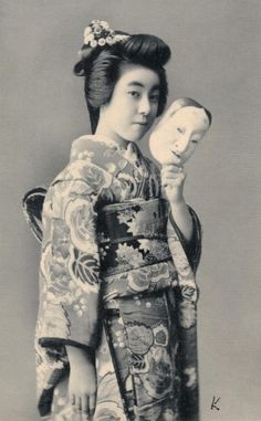 Eiryu with Noh Mask 1910s. Hangyoku (young geisha) Eiryu II of the Shinbashi geisha district in Tokyo, holding a Noh mask. Text and image via Blue Ruin 1 on Flickr