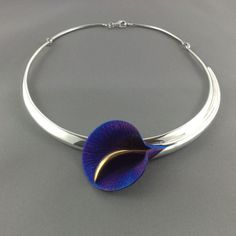 "Large calla lily silver necklace blue calla lily in titanium and 24ct gold plating. (by ""Crowded Silver"" ?)"