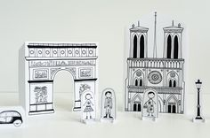 I love Joel's simple yet bold design, and his from-scratch toys are brilliant simplicity.  Should you ever want a print-out Parisian street, here you go.  I'm obsessed with the cathedral.