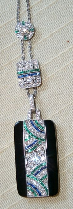 Art Deco black onyx and sapphires, emerald and diamond pendant, signed Tiffany & Co.