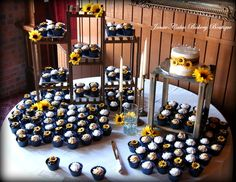 Sunflower and navy blue wedding cupcake display