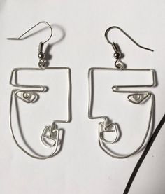 Wear these on their own, mix and matched with other studs, or in your double piercing - they are super versatile. The best everyday earrings! Beautiful earrings to give as a gift for birthda Wire Jewelry Rings, Handmade Wire Jewelry, Cute Jewelry, Wire Wrapped Jewelry, Women Jewelry, Face Earrings, Art Deco Earrings, Diy Earrings, Face Jewellery