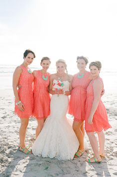coral and mint bridesmaids' outfits, photo by Nadia Meli http://ruffledblog.com/western-cape-beach-wedding #weddingideas #bridesmaidsdress