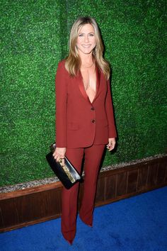 Jennifer Aniston wears a plunging red Guccitux complete with body chainsto the People's Choice Awards on January 15, 2015.
